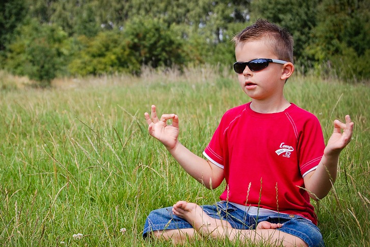 kid meditation grass